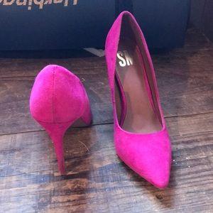 Hot pink suede pumps |